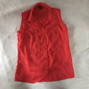 Red sleeveless button down blouse